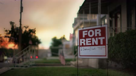 владелец : hand held footage of For Rent sign Стоковые видеозаписи