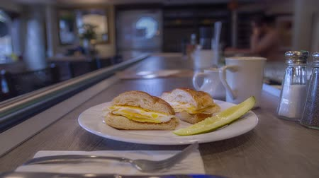 american cuisine : Egg and Cheese Sandwich at a Restaurant filmed in 4K RAW