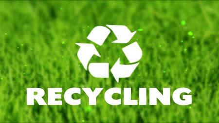 recyklace : recycling sign and logo on a background of green grass Dostupné videozáznamy