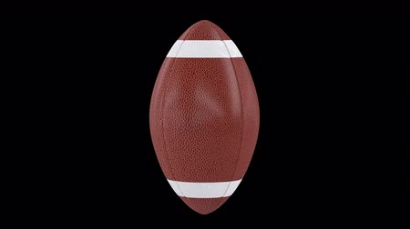 Classic American Football Ball 360 rotation loop isolated on background. Sport 3d render 360 degrees looped rotation with alpha channel.