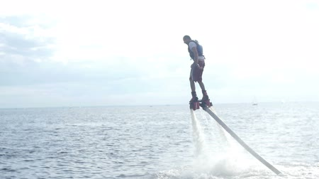 water jet : Extreme Fly Board acrobatics on sea Stock Footage
