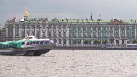 vasilevsky : Tourist Meteor floats Neva river in Saint Petersburg. Hermitage on a background.