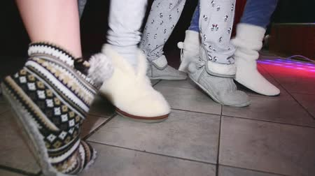 rubs : Woman feets in soft slippers synchronously rubs on floor. Party in nightclub. Stock Footage
