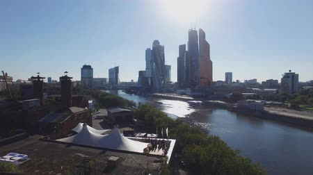 moscow panorama : Quadrocopter shoot Moscow International Business Center from riverside. Roof of restaurant. People. Summer sunny day.