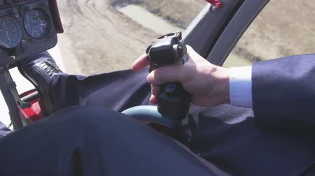 pilot in command : View at pilot take control handle to take off on helicopter. Camera inside. Pilot cabin. Flight. Transportation Stock Footage