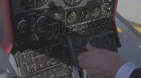 pilot in command : View at control panel system inside helicopter before take off. Camera inside. Pilot hands.Transportation