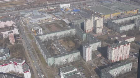 pilot in command : Aerial view from flying helicopter. Camera inside. Landscape of city, modern skyscrapers. Road. Cars. Height