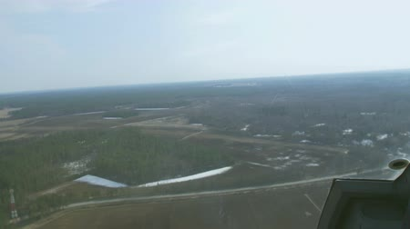 pilot in command : Aerial view from helicopter fly above green forest. Camera inside. Height. Some snow. Landscape. Transportation.