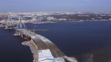pilot in command : Aerial view from helicopter fly above water. Bridge under construction. River. Sunny day. Cityscape. Height Stock Footage