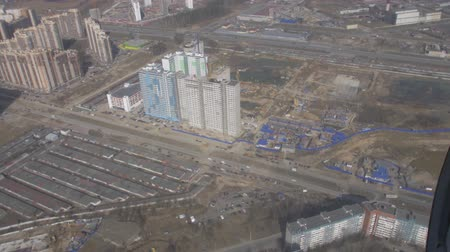 pilot in command : Aerial view from flying helicopter. Camera inside. Landscape of city. Construction site of skyscrapers. Height