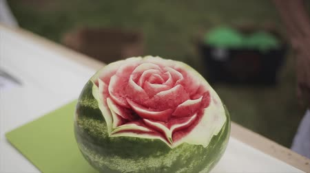 keser : View at cutted rose inside fresh watermelon. Creative cookery, service. Summer festival. Sunny day. Fruits
