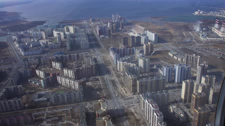 pilot in command : Aerial view from flying helicopter. Camera inside. Landscape of city at coast. Modern skyscrapers. Cars. Height Stock Footage