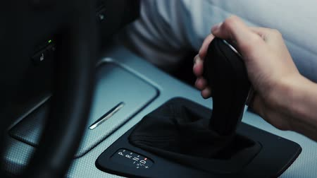 gearstick : Woman hand switching gear stick in car. Driver. Transport. Close up