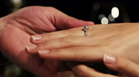 öneri : Man holding hands woman with engagement ring with diamond on finger. Proposal. Romantic moment. Stok Video