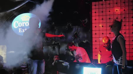 mc : Man on stage with microphone on party in nightclub. Spotlights. Smoke. Mc girl. Cheering