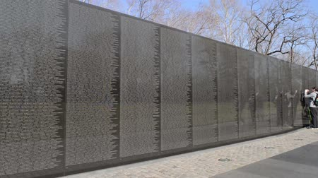 north vietnam : WASHINGTON DC -FEBRUARY 17: Names on Vietnam War Veterans Memorial on February 17, 2013 in Washington DC, USA. The memorial receives around 3 million visitors each year.