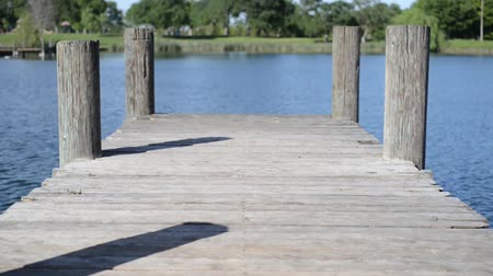 Wooden Dock with Water Moving Stok Video