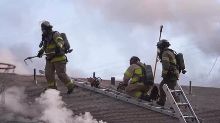 first officer : Fire Fighters On A Roof Top Flames