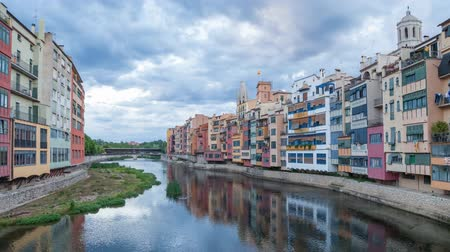 picturesque quarters : Clouds over the river Onyar in Girona, Catalonia, Spain (time-lapse video)