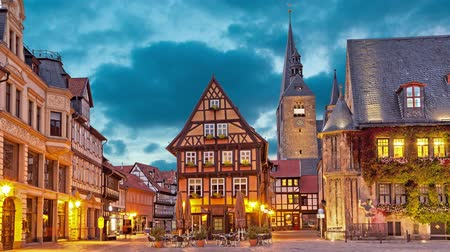 half timbered : Half-timbered house on Market Square of Quedlinburg in the evening, Germany  (static image with animated sky)