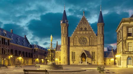 senate square : Illuminated gothic facade of Ridderzaal or Hall of Knights in Binnenhof, Hague, Netherlands (static image with animated sky)