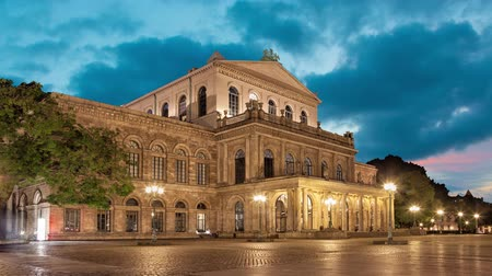 hanover : Building of Hannover State Opera in the evening,  Lower Saxony, Germany  (static image with animated sky)