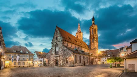 Catolic cathedral on munsterplatz square in Villingen-Schwenningen at dusk, Germany  (static image with animated sky) Стоковые видеозаписи