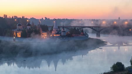 volga region : Fog swirls over the Volga river beside of Staritskiy Holy Dormition Monastery in Staritsa, Tverskaya oblast, Russia
