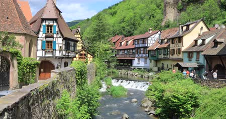half timbered : Kayserberg, France - May 13 2017: French traditional half-timbered houses and La Weiss river in Kayserberg village in Alsace