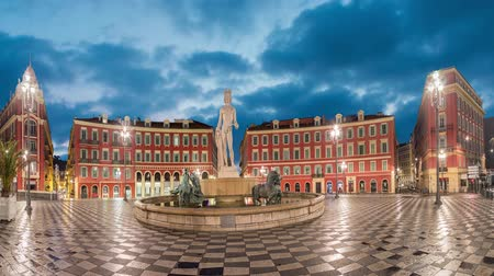 rivera : Fontaine du Soleil on Place Massena square at dusk in Nice, Alpes-Maritimes, France (static image with animated sky)