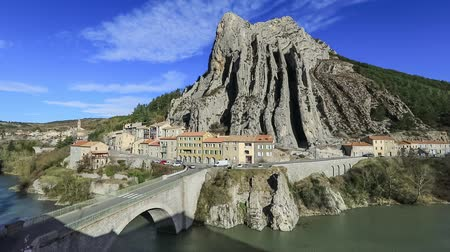 alpes : The Rocher de la Baume - unusual shaped rock and bridge over Durance river in Sisteron, Alpes-de-Haute-Provence, France Stock Footage