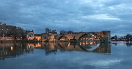 alpes : Zoom in view on Pont dAvignon 12th century bridge and city skyline at dusk in Avignon, Provence, France Stock Footage