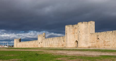 View of surrounding wall of Aigues-Mortes medieval fortified city, Occitanie, France (time lapse video)