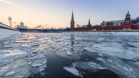 Ice floating on Moskva river in front of Kremlin wall on sunset in Moscow, Russia
