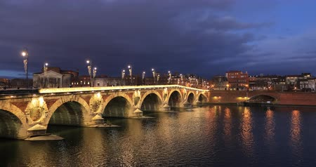 Static view of Pont Neuf (New Bridge) over Garonne river at dusk in Toulouse, France