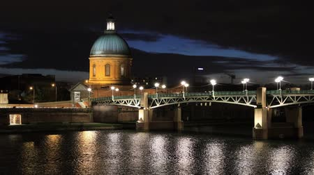Chapel of Saint-Joseph de la Grave and Pont Saint Pierre bridge at dusk in Toulouse, Haute-Garonne, France