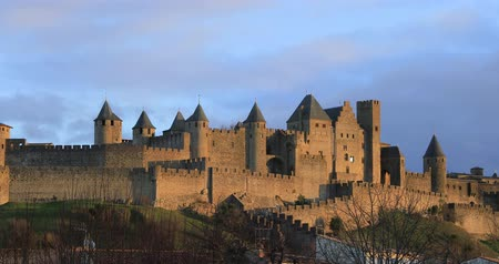 Walls and towers of Carcassonne in light of setting sun, Aude, France (zoom in view)