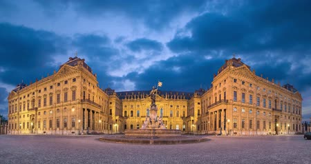 View of illuminated Wurzburg Residence palace from Residenzplatz square in the evening, Wurzburg, Germany  (static image with animated sky)