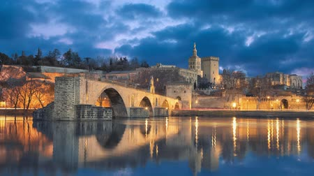 refletindo : View on Pont dAvignon 12th century bridge and city skyline in Avignon, Provence, France (static image with animated sky and water) Stock Footage