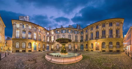 alpes : Aix-en-Provence, France. Panorama of Place DAlbertas square with old fountain at dusk (static image with animated sky and water)