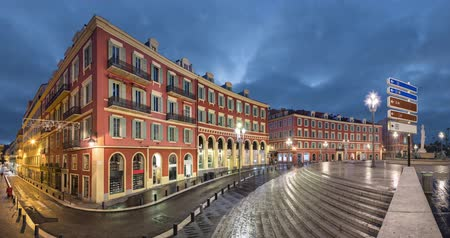 Place Massena square with red buildings at dusk in Nice, France (static image with animated sky) Стоковые видеозаписи
