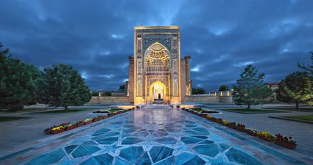 Entrance portal to Gur-e-Amir - a mausoleum of the Asian conqueror Timur in Samarkand, Uzbekistan (static image with animated sky)