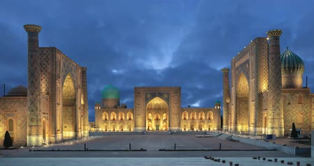 Samarkand at dusk. Historic Registan square with three madrasahs (static image with animated sky)