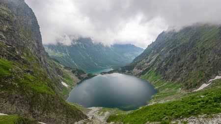 Czarny Staw pod Rysami (Black Lake below Mount Rysy) and  Morskie Oko lakes in Tatra Mountains, Poland (time lapse video) Стоковые видеозаписи