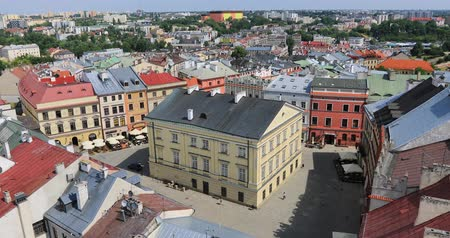 lesser : Aerial zoom in view of Rynek square in old town of Lublin from Trynitarska Tower, Poland Stock Footage