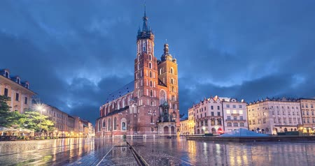 street market : Basilica of Saint Mary at dusk with reflection in Krakow, Poland (static image with animated sky)