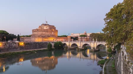 Day to night time lapse video of Castel SantAngelo and bridge over Tiber river in Rome, Italy