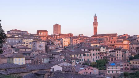 Day to night time lapse cityscape of Siena, Tuscany, Italy