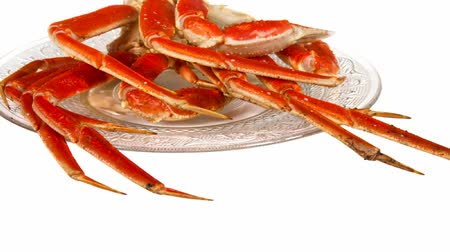 crustáceo : Crab legs on a glass plate