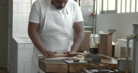 chef cooking : african american chef roll out a dough